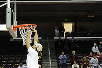 March 14, 2010.  Grace Mashore cuts down the net after the Stanford Cardinal beat the UCLA Bruins to win the 2010 Pac-10 Tournament.