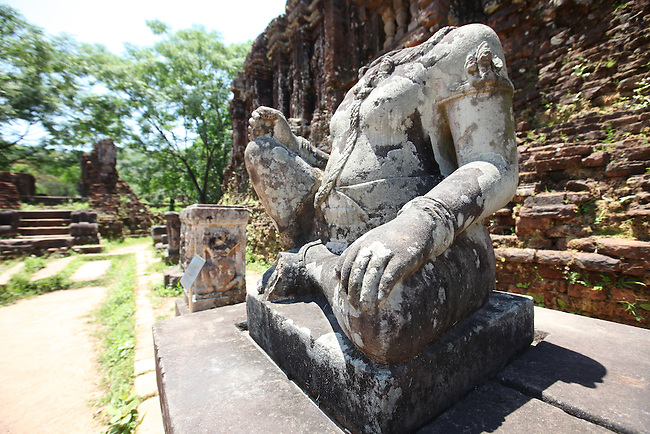 The headless statue of a Hindu diety sits outside a temple at the ancient site of My Son, Vietnam. The site was the primary religious center and royal burial grounds for the Champa kingdom, which flourished from 400 to 1500 A.D. and encompassed most of south and central Vietnam.  The temples were dedicated to the worship of the Hindu god Shiva. The most important structures were excavated and restored under French colonial rule, but many were heavily damaged or completely destroyed by American bombing during the Vietnam War. April 25, 2012.