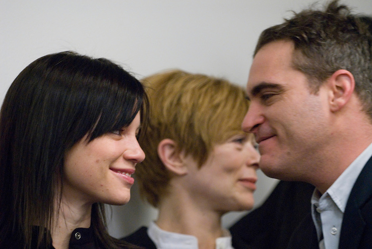 Actress Amy Smart and actor Joaquin Phoenix talk during Rep. Dennis Kucinich's news conference to reintroduce the Department of Peace and Nonviolence Bill on Tuesday, Feb. 6, 2007.