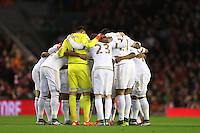 The Swansea team huddle ahead of the Barclays Premier League Match between Liverpool and Swansea City played at Anfield, Liverpool on 29th November 2015