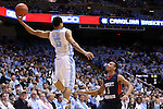 16 November 2014: North Carolina's Marcus Paige (left) saves a ball from going out of bounds as Robert Morris's Elijah Minnie (right) watches. The University of North Carolina Tar Heels played the Robert Morris University Colonials in an NCAA Division I Men's basketball game at the Dean E. Smith Center in Chapel Hill, North Carolina. UNC won the game 103-59.
