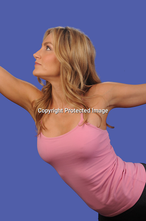 Stock photo of Feminine woman doing yoga