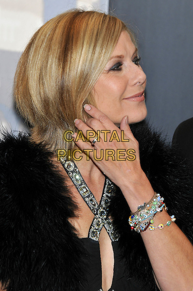GLYNIS BARBER .at the Crime Thriller Awards, Grosvenor House Hotel, London, England, UK, October 21st 2009..portrait headshot jeweled jewelled jewel encrusted beaded embellished halterneck strap fur fluffy profile hand touching bracelet ring .CAP/PL.©Phil Loftus/Capital Pictures.
