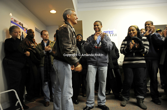 Rahm Emanuel greets the crowd at the opening of his first field office for his campaign for Chicago mayor in the South Side neighborhood of Hyde Park, home to U.S. President Barack Obama, in Chicago, Illinois on December 11, 2010.