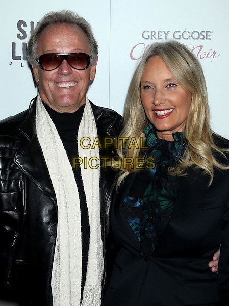 """Peter Fonda & Margaret 'Parky' DeVogelaere.""""Silver Linings Playbook"""" - Los Angeles Special Screening held at the Academy of Motion Picture Arts and Sciences Samuel Goldwyn Theater, Beverly Hills, California, USA..November 19th, 2012.half length black leather jacket teal white scarf sunglasses shades blue ruffle green blouse married husband wife .CAP/ADM/RE.©Russ Elliot/AdMedia/Capital Pictures."""