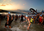 KONA-KAILUA, HI - OCTOBER 11:  Male competitors begin the 2.4-mile Waikiki Roughwater Swim at the 2014 IRONMAN Triathlon World Championships presented by GoPro on October 11, 2014 in Kailua-Kona, Hawaii. (Photo by Donald Miralle) *** Local Caption ***