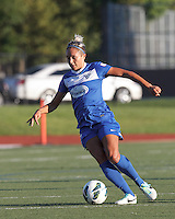 Boston Breakers forward Kyah Simon (17) brings the ball forward.  In a National Women's Soccer League (NWSL) match, Boston Breakers (blue) defeated FC Kansas City (white), 1-0, at Dilboy Stadium on August 10, 2013.