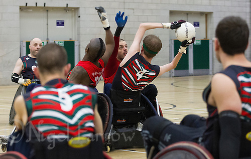 27 MAY 2013 - DONCASTER, GBR - Leicester Tigers players watch as Nick Cummins attempts to pass during the 2013 Great Britain Wheelchair Rugby Nationals 5th / 6th position decider against the East Midlands Marauders at The Dome in Doncaster, South Yorkshire, Great Britain (PHOTO (C) 2013 NIGEL FARROW)