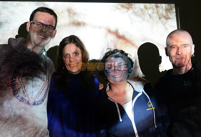 In the picture – members of the Nexus Arts Group Declan Kelly, Els Borghart, Kate Richardson and Noel Feeney illuminated by the projected image of one of the installations at the Insight/Insounds audio visual group exhibition at Barlow House. Photo: Andy Spearman. www.newsfile.ie