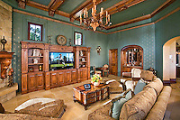 Family Room With Eccentric Chandelier And Wood Ceiling