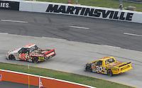 Mar 31, 2007; Martinsville, VA, USA; Nascar Craftsman Truck Series driver Mike Skinner (5) leads Todd Bodine (30) during the Kroger 250 at Martinsville Speedway. Mandatory Credit: Mark J. Rebilas.