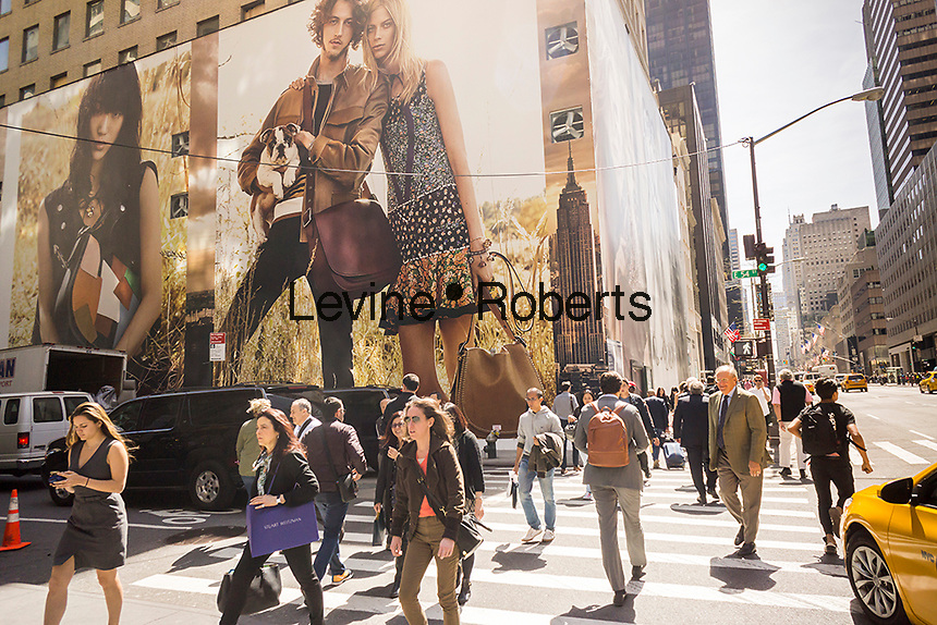 """Giant billboards for Coach adorn the construction shed for the new """"Coach House"""" on Fifth Avenue in New York on Monday, April 18, 2016. Coach announced it will open a ritzy store on expensive Fifth Avenue in an effort the raise the luxury status of their brand. The space will be 23,400 square feet with the Stuart Weitzman store adjacent on the avenue where rents can run $4000 a square foot. They are scheduled to open in Fall 2016.(© Richard B. Levine)"""