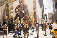 "Giant billboards for Coach adorn the construction shed for the new ""Coach House"" on Fifth Avenue in New York on Monday, April 18, 2016. Coach announced it will open a ritzy store on expensive Fifth Avenue in an effort the raise the luxury status of their brand. The space will be 23,400 square feet with the Stuart Weitzman store adjacent on the avenue where rents can run $4000 a square foot. They are scheduled to open in Fall 2016.(© Richard B. Levine)"