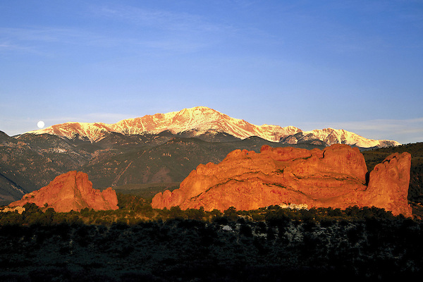 Sunrise with full moon and Pikes Peak, Garden of the Gods State Park, Colorado Springs, Colorado. John leads private photo tours throughout Colorado, year-round.