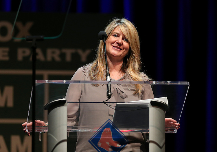 """Lynne Bohan, vice president of communications and government affairs at HP Hood, speaks during the Red Sox Foundation's annual """"Welcome Home Party,"""" a fundraiser to benefit the Foundation's programs for the families of New England at the House of Blues in Boston on Friday, April 4, 2014. (Brita Meng Outzen/Boston Red Sox)"""