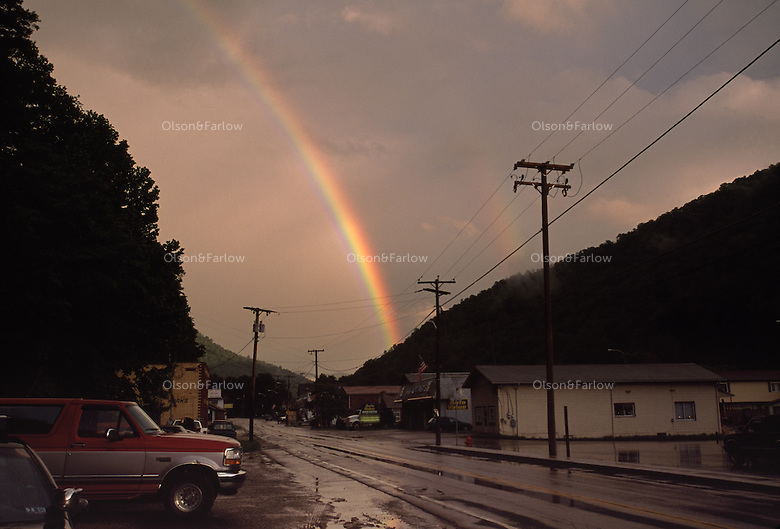 Rainbows lead to the town of Sylvester after a summer evening thunderstorm.