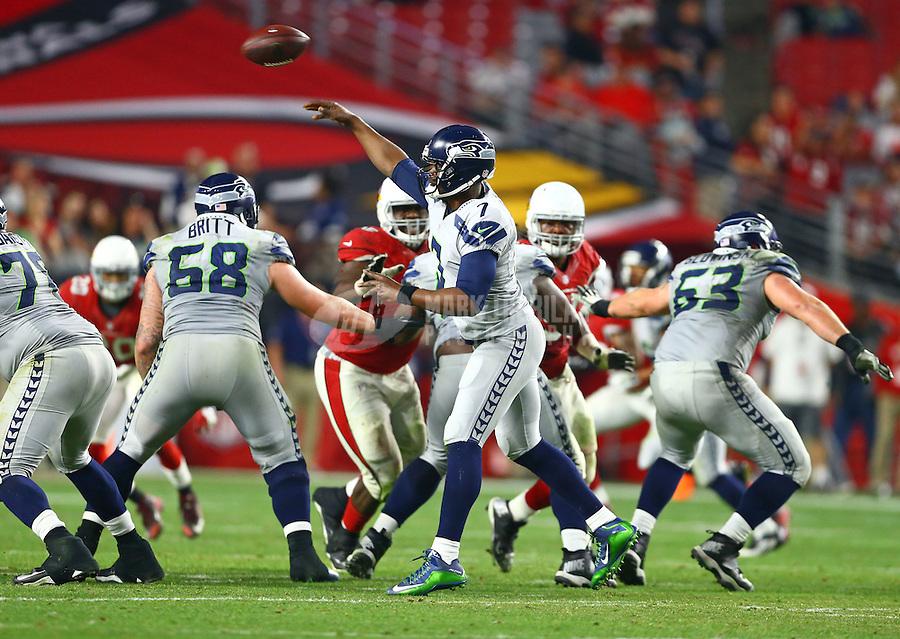 Jan 3, 2016; Glendale, AZ, USA; Seattle Seahawks quarterback Tarvaris Jackson (7) throws a pass in the fourth quarter against the Arizona Cardinals at University of Phoenix Stadium. Mandatory Credit: Mark J. Rebilas-USA TODAY Sports
