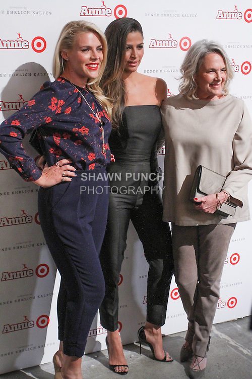 Actress Busy Philipps (left) and model Camila Alves (center) and costume designer Renee Ehrlich Kalfus arrive at the Annie For Target collection celebration and pop-up shop at Stage 37 in New York City on November 4, 2014.