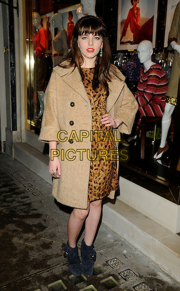 OPHELIA LOVIBOND .At the Tory Burch Flagship Store Launch, New Bond Street, London, England, UK January 25th 2011..full length camel brown coat hand on hip leopard animal print black suede ankle boots .CAP/CAN.©Can Nguyen/Capital Pictures.