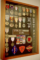 NWA Democrat-Gazette/DAVID GOTTSCHALK   The shadow box  of Marine Lt. Col. E.S. Lawbaugh, retired, Wednesday, May 2, 2017, holding medals and decorations from his military career in his home in Fayetteville. Lawbaugh served with four men whose names are on the Vietnam Wall. A portable version of the wall is coming to Northwest Arkansas on May 18-22.