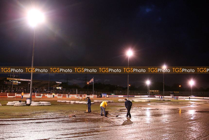 Track staff try in vain to make the track fir for racing after torrential rain falls - Lakeside Hammers vs Ipswich Witches - Sky Sports Elite League Speedway at Arena Essex Raceway, Purfleet - 28 /08/09 - MANDATORY CREDIT: Gavin Ellis/TGSPHOTO - Self billing applies where appropriate - Tel: 0845 094 6026