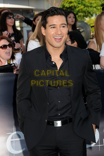 "MARIO LOPEZ .""The Twilight Saga: Eclipse"" Los Angeles Premiere at the 2010 Los Angeles Film Festival held at Nokia Theatre LA Live, Los Angeles, California, USA, 24th June 2010..half length hands in pockets suit shirt smiling  black .CAP/ADM/BP.©Byron Purvis/AdMedia/Capital Pictures."