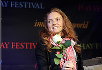 Sunday 25 May 2014, Hay on Wye, UK<br /> Pictured: Model Lily Cole holding flower<br /> Re: The Hay Festival, Hay on Wye, Powys, Wales UK.