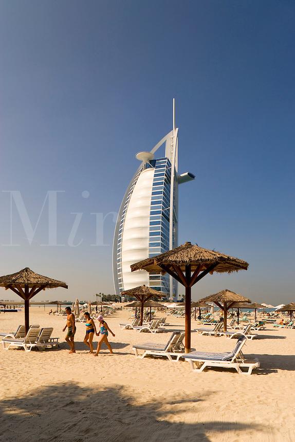 Dubai.  View over beach of Jumeirah Beach Hotel of Burj al Arab Hotel, architect W.S. Atkins, an icon of Dubai built in the shape of the sail of a dhow, stands on an island off Jumeirah Beach.  .