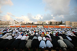 Palestinians attend the early morning Eid prayer that marks the end of the holy month of Ramadan, at a football stadium in Gaza City on September 20, 2009. Muslims pray early in the morning on Eid al-Fitr after a month of fasting. . Photo by Mohammed Othman