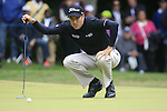 Ross Fisher (ENG) lines up his putt on the 1st green during the Final Day of the BMW PGA Championship Championship at, Wentworth Club, Surrey, England, 29th May 2011. (Photo Eoin Clarke/Golffile 2011)