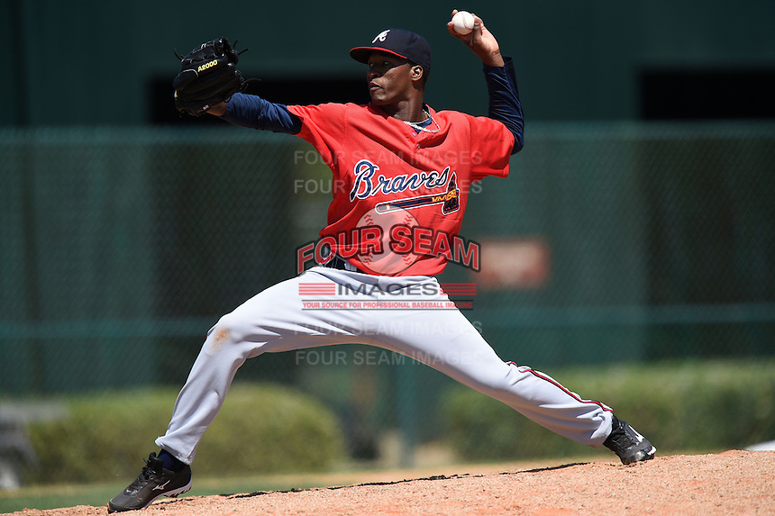 Atlanta Braves pitcher Michael Flores (12) during a minor league spring training game against the Washington Nationals on March 26, 2014 at Wide World of Sports in Orlando, Florida.  (Mike Janes/Four Seam Images)