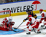 January 26, 2020: Sacred Heart goalie Josh Benson (red) makes one of his 21 saves as the Pioneers upset 17th ranked Quinnipiac 4-1 in the Connecticut Ice Tourney. The inaugural event was held at the Webster Bank Arena in Bridgeport, Connecticut.  Heary/Eclipse Sportswire/CSM