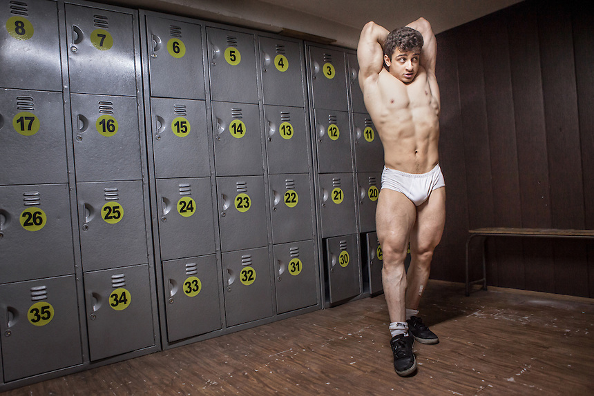 Masih Farzaneh, an Iranian bodybuilder, stretch his muscles inside the locker room of a gym at Jolfa, the Armenian quarter of Isfahan. In a men-centered society as Iran, for many Iranian men, masculinity is a pride to be pursued.