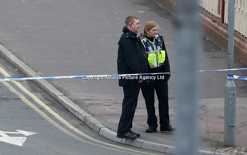 Police officers block off the area leading to the scene of a road traffic collision on Newport Bridge after a female pedestrian was hit by a silver Ford Focus leaving her in a critical condition, Newport, south Wales, UK. Thursday 23 March 2017