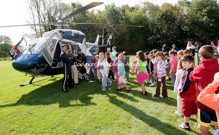 BETHLEHEM, CT-27September 2006-092706TK06- As part of a Bethlehem Elementary School PTO promotion of a Safety Week program, the LifeStar helicopter landed at the Elementary School field Wednesday morning. Ric Shotwell, a EMS helicopter associated with Hartford Hospital for 12 years, welcomes the students boarding the helicopter. Tom Kabelka Republican-American (Bethlehem Elementary School, LifeStar helicopter, Ric Shotwell)