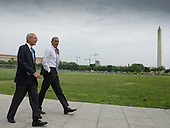 United States President Barack Obama (right) walks from the White House to the United States Department of the Interior to sign an Executive Order accompanied by White House Counselor John Podesta (left), Wednesday May 21, 2014 on the Ellipse in Washington, DC.<br /> Credit: John Harrington / Pool via CNP