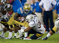 Mychal Kendricks of California tackles Derrick Coleman of UCLA during the game at Rose Bowl in Pasadena, California on October 29th, 2011.  UCLA defeated California, 31-14.
