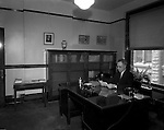 Pittsburgh PA: Administrator reading documents in hid office at Duquesne University - 1932