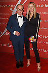 Tommy Hilfiger and Dee Hilfiger arrive at The Fashion Group International's Night of Stars 2017 gala at Cipriani Wall Street on October 26, 2017.