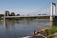Bridge over the river. Man fishing. Cosne sur Loire, France