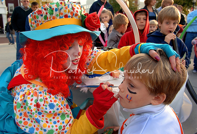 A young boy gets his face painted by Bubbles the Clown during an event at Birkdale Village in Huntersville, NC. Birkdale Village combines the best of shopping, dining, apartments and entertainment venues within a 52-acre mixed-use development.