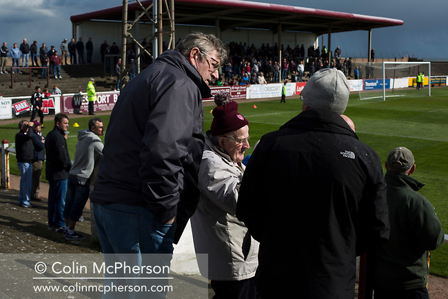 Home supporters chatting during a break in play during the first-half at Gayfield Park as Arbroath hosted Edinburgh City (in yellow) in an SPFL League 2 fixture. The newly-promoted side from the Capital were looking to secure their place in SPFL League 2 after promotion from the Lowland League the previous season. They won the match 1-0 with an injury time goal watched by 775 spectators to keep them 4 points clear of bottom spot with three further games to play.
