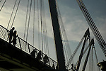 Golden Jubilee Bridge (Hungerford Bridge) silhouetted against sky, London England