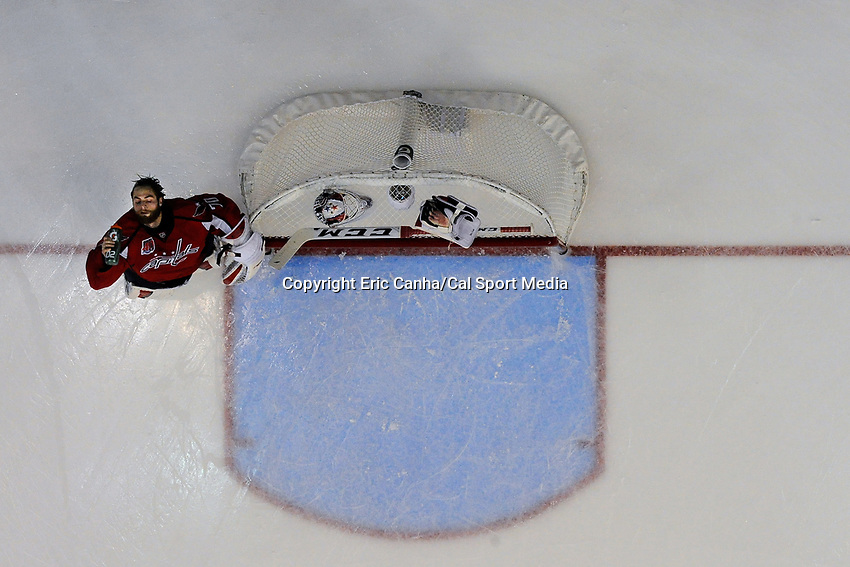 April 23, 2015 - Washington D.C., U.S. - Washington Capitals goalie Braden Holtby (70) splashes water on his face before the start of game 5 of the  NHL Eastern Conference Quarter finals between the New York Islanders and the Washington Capitals held at the Verizon Center in Washington DC. The Capitals defeat the Islanders 5-1 in regulation time to take the lead in the 7 game series 3-2. Eric Canha/CSM