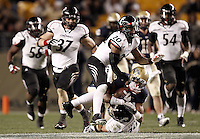 PITTSBURGH, PA - NOVEMBER 05:  Devin Street #15 of the Pittsburgh Panthers is tackled by Drew Frey #26 and Chris Williams #20 of the Cincinnati Bearcats on November 5, 2011 at Heinz Field in Pittsburgh, Pennsylvania.  (Photo by Jared Wickerham/Getty Images)