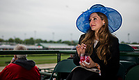 LOUISVILLE, KY - MAY 06: A woman stirs her Oaks Lily on Kentucky Derby Day at Churchill Downs on May 6, 2017 in Louisville, Kentucky. (Photo by Douglas DeFelice/Eclipse Sportswire/Getty Images)