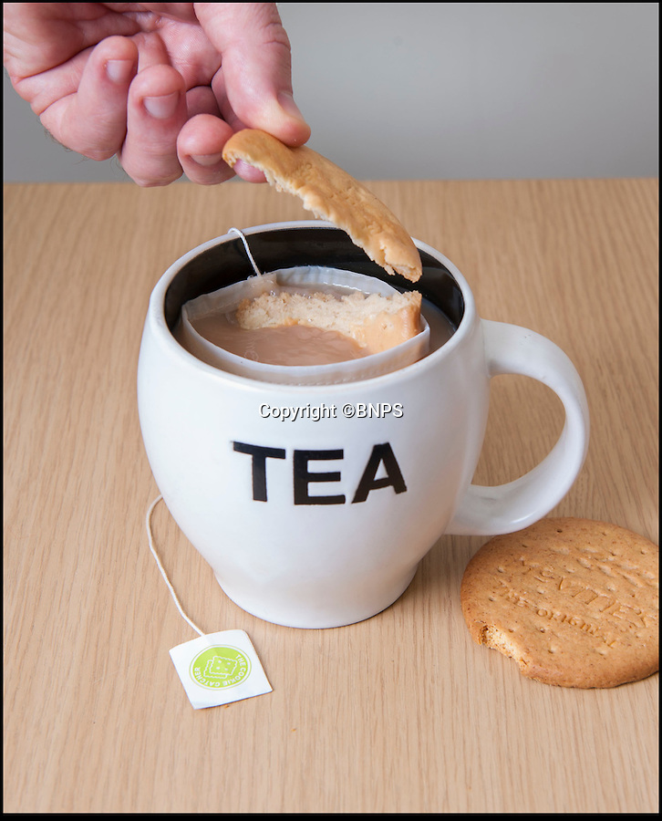 BNPS.co.uk (01202 558833)<br /> Pic: PhilYeomans/BNPS<br /> <br /> Finally...An end to the Tea-break terror...<br /> <br /> Well held...<br /> <br /> Tea drinkers are rejoicing after a nifty device designed to catch crumbs left by dunking biscuits in your brew hit the shelves.<br /> <br /> Dad of two Andrew Tinsley solved the age-old problem with a canny mesh pouch which sits inside a mug of tea collecting any unwanted biscuit bits that might float off during dunking.<br /> <br /> And should your Digestive or Rich Tea become too soggy and break off altogether this cheap and cheerful gadget will guarantee drinkers are not left with a heap of biscuity sludge at the bottom of their cup.<br /> <br /> Entrepreneur Andrew, 49, dreamed up the product, called the Cookie Catcher, after watching family members lose their sodden biscuits in their tea after dunking them for too long during Christmas celebrations last year.