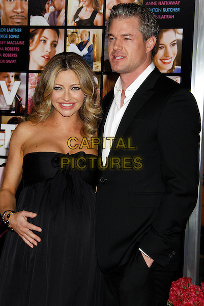 """REBECCA GAYHEART & ERIC DANE .""""Valentine's Day"""" Los Angeles Premiere - arrivals held at Grauman's Chinese Theatre, Hollywood, California, USA, .8th February 2010. .half length black strapless dress pregnant maternity hand married couple husband wife suit white shirt smiling in pocket .CAP/ADM/MJ.©Michael Jade/AdMedia/Capital Pictures."""