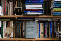 "A copy of David Armitage's book ""Civil Wars: A History in Ideas"" stands on a bookshelf in Armitage's office in Robinson Hall in Harvard Yard on Tues., June 13, 2017.  David Armitage is the Lloyd C. Blankfein Professor of History in Harvard University's Department of History. The book looks at the roots and circumstances of civil wars throughout history."