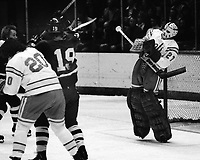 Seals vs Pittsburg Penguins, Seal goalir Gilles Meloche makes save. (photo 1975/Ron Riesterer)